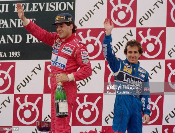 Ayrton Senna of Brazil and driver of the Marlboro McLarenMcLaren MP4/8Ford HBE7 V8 stands on the podium with second placed Alain Prost after winning...