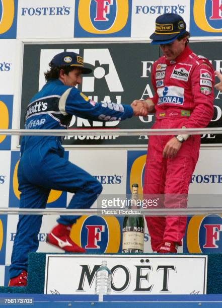 Ayrton Senna of Brazil and driver of the Marlboro McLarenMcLaren MP4/8Ford HBE7 V8 openly welcomes second placed Alain Prost on to the top step of...