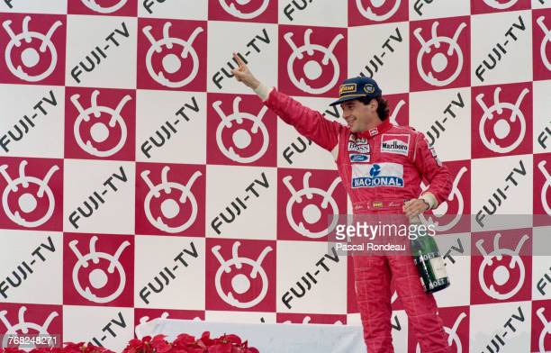Ayrton Senna of Brazil and driver of the Marlboro McLarenMcLaren MP4/8Ford HBE7 V8 stands on the podium after winning the Japanese Grand Prix on 24...