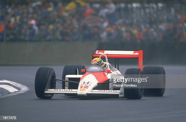Ayrton Senna of Brazil cuts close to a corner in his McLaren Honda during the British Grand Prix at the Silverstone circuit in England Senna finished...