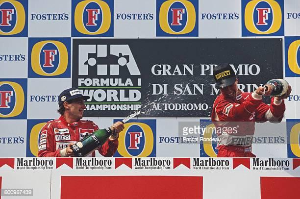 Ayrton Senna of Brazil, driver of the Honda Marlboro McLaren McLaren MP4/6 Honda RA121E V10 sprays champagne over third placed JJ Lehto of Finland,...