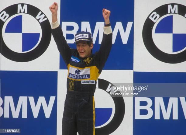 Ayrton Senna of Brazil, driver of the John Player Special Team Lotus Lotus 97T Renault V6, turbo celebrates winning his first Grand Prix at the...