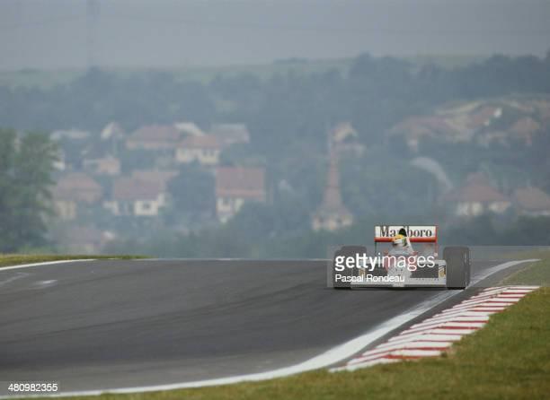 Ayrton Senna of Brazil drives the Honda Marlboro McLaren McLaren MP4/5 Honda RA109A V10 during practice for the Hungarian Grand Prix on 12th August...