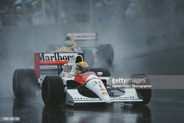 Ayrton Senna of Brazil drives the Honda Marlboro McLaren McLaren MP4-6 ahead of Nigel Mansell in the Canon Williams Renault Williams FW14 in the rain...