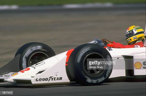 Ayrton Senna of Brazil in action in his McLaren Honda during the British Grand Prix at the Silverstone circuit in England Senna finished in first...