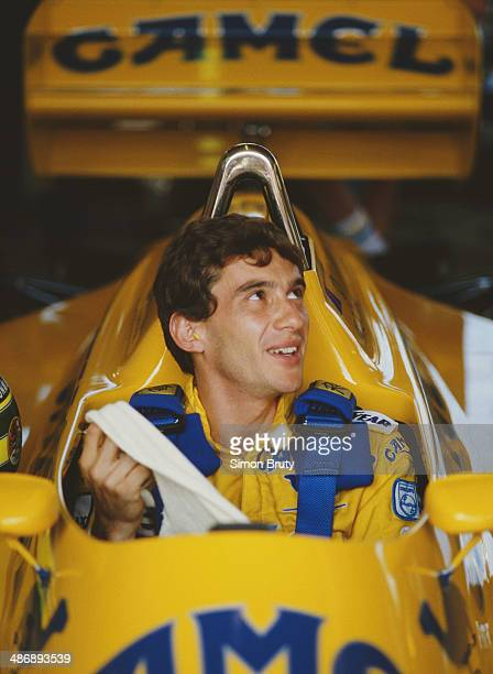 Ayrton Senna of Brazil sits aboard the Camel Team Lotus Honda Lotus 99T Honda RA166E V6 turbo during practice for the Brazilian Grand Prix on 11th...
