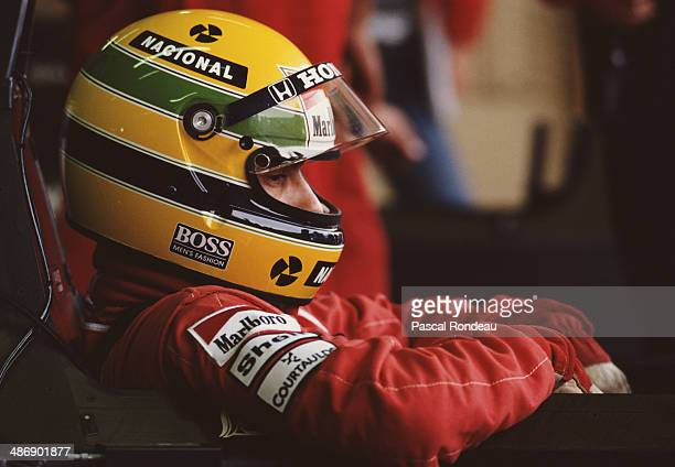 Ayrton Senna of Brazil sits aboard the Honda Marlboro McLaren McLaren MP4/5 Honda V10 before the Fuji Television Japanese Grand Prix on 22nd October...