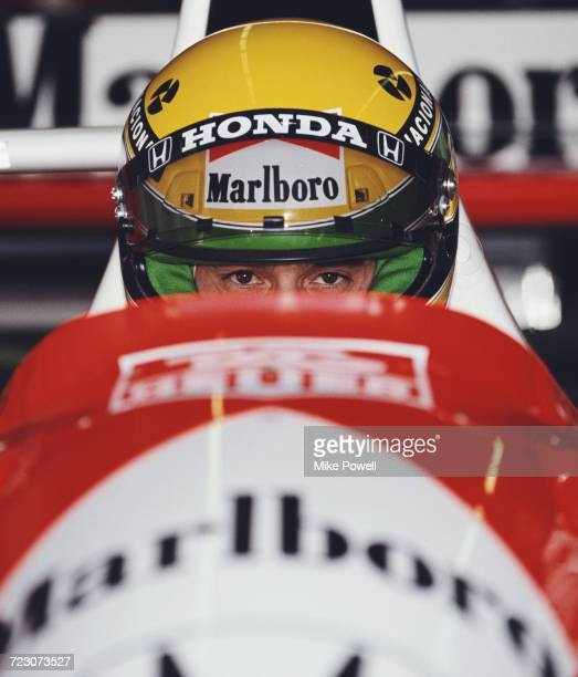 Ayrton Senna of Brazil sits aboard the Honda Marlboro McLaren McLaren MP4/6 Honda V12 during practice for the Iceberg United States Grand Prix on 9...