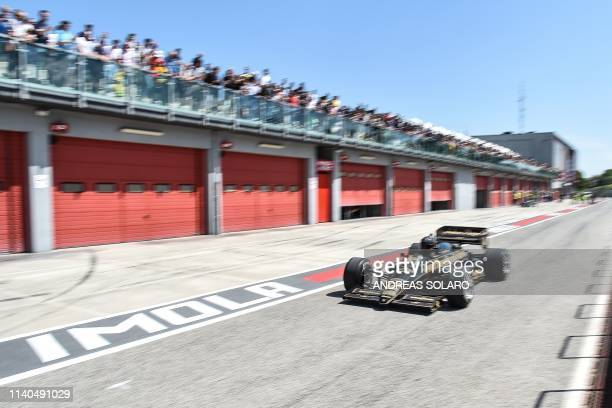 Ayrton Senna's Lotus 1985 JPS team drives past the pit line on May 1 2019 during a ceremony marking the 25th anniversary of the death of Brazilian's...