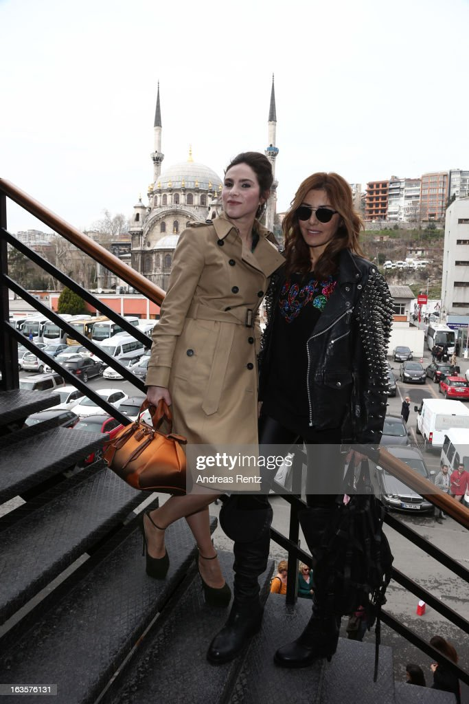 Ayse Kucuroglu and Deniz Berdan attend Mercedes-Benz Fashion Week Istanbul Fall/Winter 2013/14 at Antrepo 3 on March 12, 2013 in Istanbul, Turkey.
