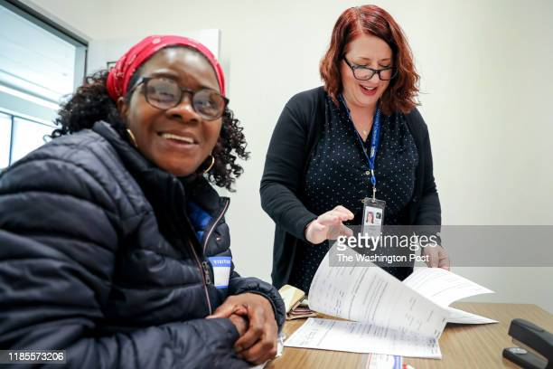 COLUMBIA MARYLAND NOVEMBER 25 Ayse Tokbay right walks Cydney Franklin through her Medicare options at the Howard County Office on Aging and...
