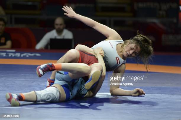 Aysun Erge of Turkey in action against Karalina Tjapko of Latvia during the women's 53kg category match within the 2018 European Wrestling...
