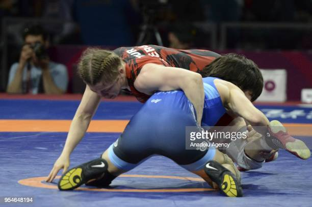 Aysun Erge of Turkey in action against Maria Prevolaraki of Greece during the women's 53kg category match within the 2018 European Wrestling...