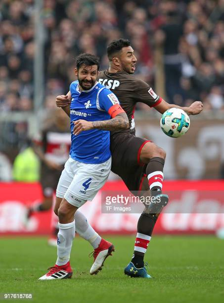 Aytac Sulu of Darmstadt and Aziz Bouhaddouz of St Pauli battle for the ball during the Second Bundesliga match between FC St Pauli and SV Darmstadt...