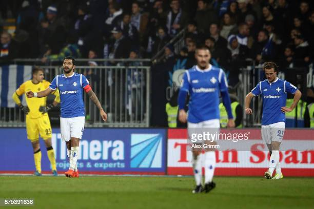 Aytac Sulu of Darmstadt and team mates react after Richard SukutaPasu of Sandhausen scored his team's second goal during the Second Bundesliga match...