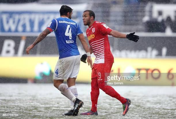 Aytac Sulu of Darmstadt argues with Jann George of Regensburg during the Second Bundesliga match between SV Darmstadt 98 and SSV Jahn Regensburg at...