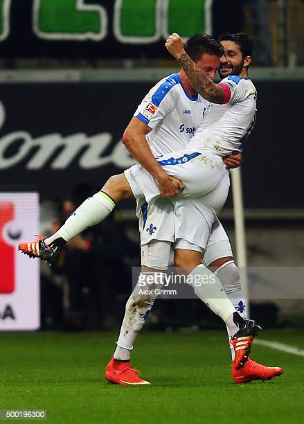 Aytac Sulu of Darmstadt celebrates his team's first goal with team mate Sandro Wagner during the Bundesliga match between Eintracht Frankfurt and SV...
