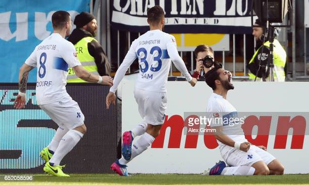 Aytac Sulu of Darmstadt celebrates his team's first goal with team mates during the Bundesliga match between SV Darmstadt 98 and 1 FSV Mainz 05 at...