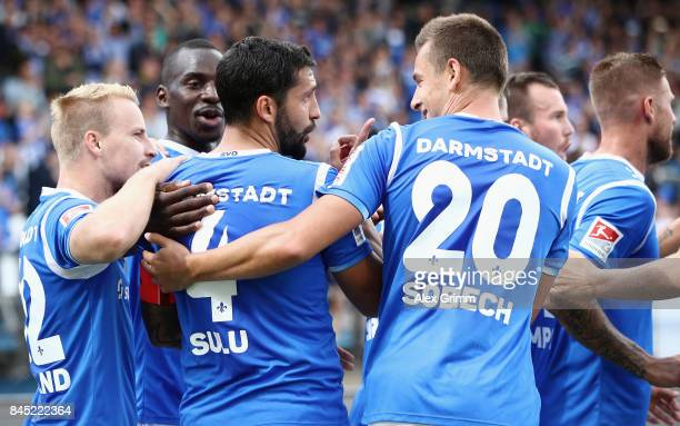 Aytac Sulu of Darmstadt celebrates his team's first goal with team mates during the Second Bundesliga match between SV Darmstadt 98 and VfL Bochum...