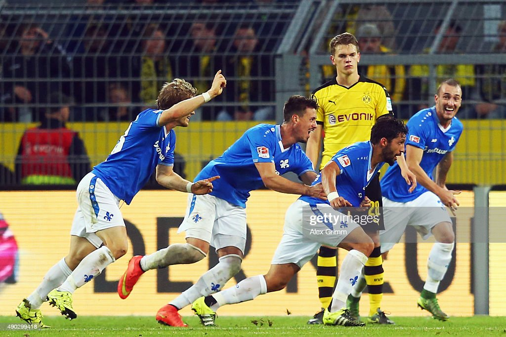 Aytac Sulu of Darmstadt celebrates his team's second goal with team mates Sandro Wagner and Florian Jungwirth (R-L) during the Bundesliga match between Borussia Dortmund and SV Darmstadt 98 at Signal Iduna Park on September 27, 2015 in Dortmund, Germany.