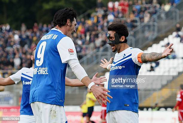 Aytac Sulu of Darmstadt celebrates with his team-mates after scoring his team's second goal during the Second Bundesliga match between SV Darmstadt...