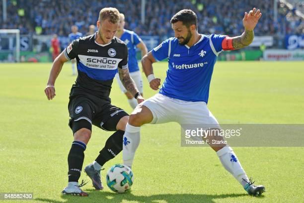 Aytac Sulu of Darmstadt tackles Christoph Hemlein of Bielefeld during the Second Bundesliga match between SV Darmstadt 98 and DSC Arminia Bielefeld...