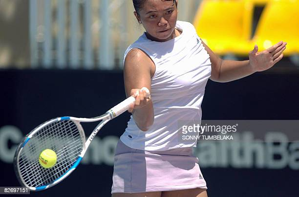 Ayu Fani Damayanti of Indonesia hits a return against compatriot Lavinia Tananta during a qualification round of the Bali international tennis...