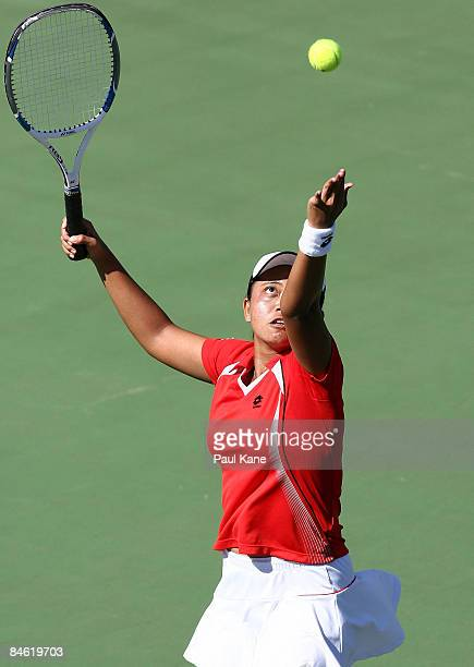 Ayu Fani Damayanti of Indonesia serves during the doubles match of the first round Fed Cup draw between Uzbekistan and Indonesia at The State Tennis...
