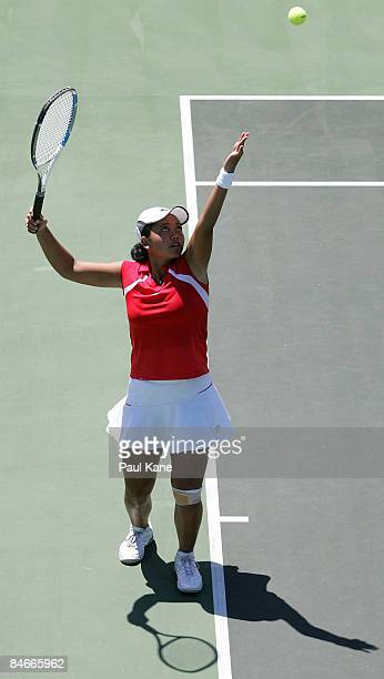 Ayu Fani Damayanti of Indonesia serves to Dianne Hollands of New Zealand during day three of the Fed Cup Asia/Oceania Zone Group 1 2 match between...