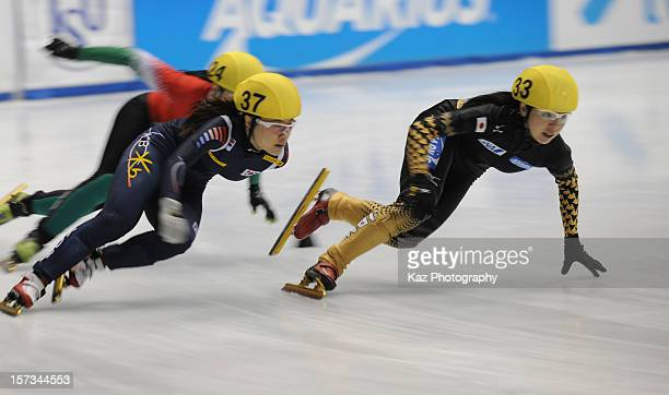 Ayuko Ito of Japan leads Race 1 of Ladies 1500m Semifinals followed by MinJung Kim of Korea during day three of the ISU World Cup Short Track at...