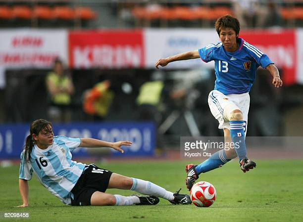 Ayumi Hara of Japan and Maria Gimena Blanco of Argentina in action during the women's international friendly soccer match between Japan and Argentina...
