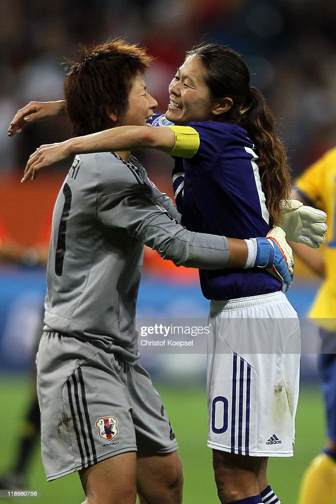 Ayumi Kaihori of Japan and Homare Sawa of Japan celebrate winning 3-1 the FIFA Women's World Cup Semi Final match between Japan and Sweden at the FIFA World Cup stadium Frankfurt on July 13, 2011 in Frankfurt am Main, Germany.
