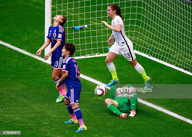 Ayumi Kaihori of Japan lays on the pitch in front of Alex Morgan after Tobin Heath of the United States scores in the second half in the FIFA Women's...