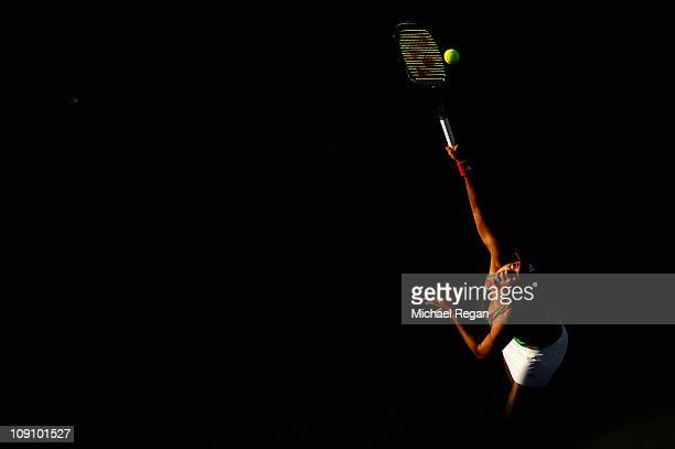 Ayumi Morita of Japan serves during her Round 1 match against Petra Kvitova of the Czech Republic during day two of the WTA Dubai Duty Free Tennis...