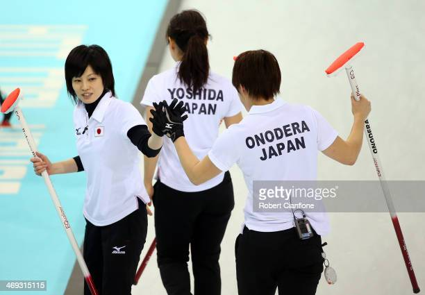 Ayumi Ogasawara of Japan acknowledges her team mates Chinami Yoshida and Kaho Onodera during the Curling Women's Round Robin match between Japan and...