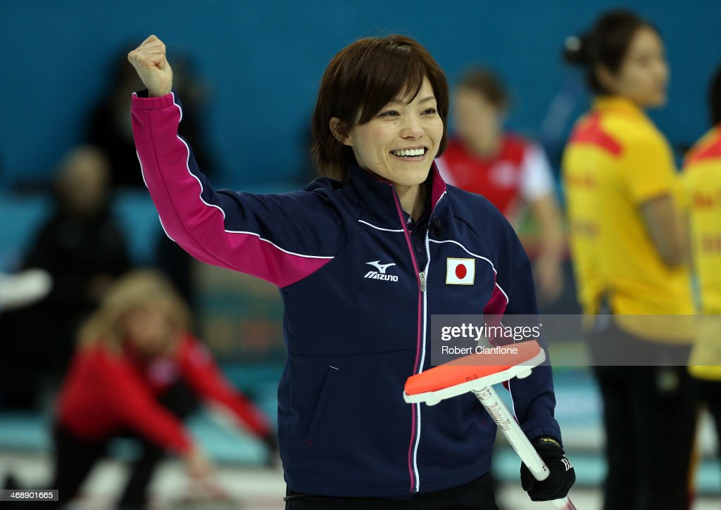 Ayumi Ogasawara of Japan celebrates after Japan won an end during Curling Women's Round Robin match between Japan and Russia during day five of the Sochi 2014 Winter Olympics at Ice Cube Curling Center on February 12, 2014 in Sochi, Russia.
