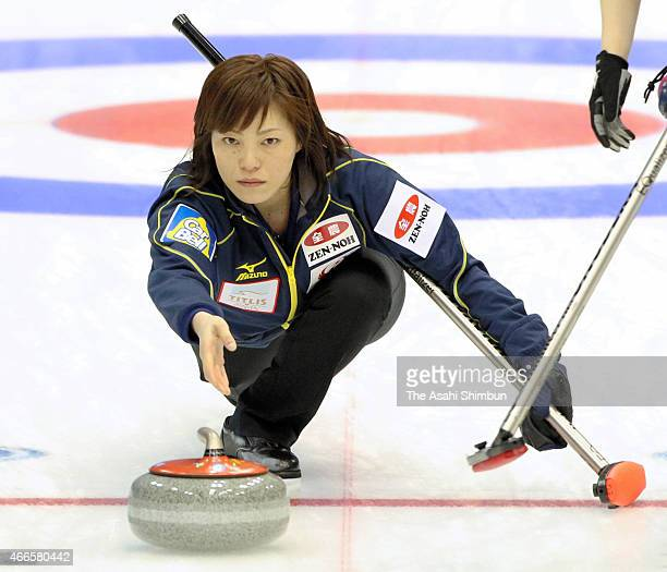 Ayumi Ogasawara of Japan delivers the stone during a round-robin match between Japan and Finland during day three of the World Women's Curling...