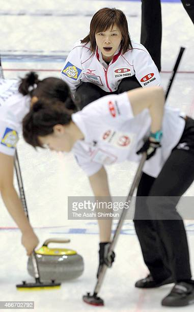 Ayumi Ogasawara of Japan delivers the stone during a round-robin match between Japan and Russia during day four of the World Women's Curling...