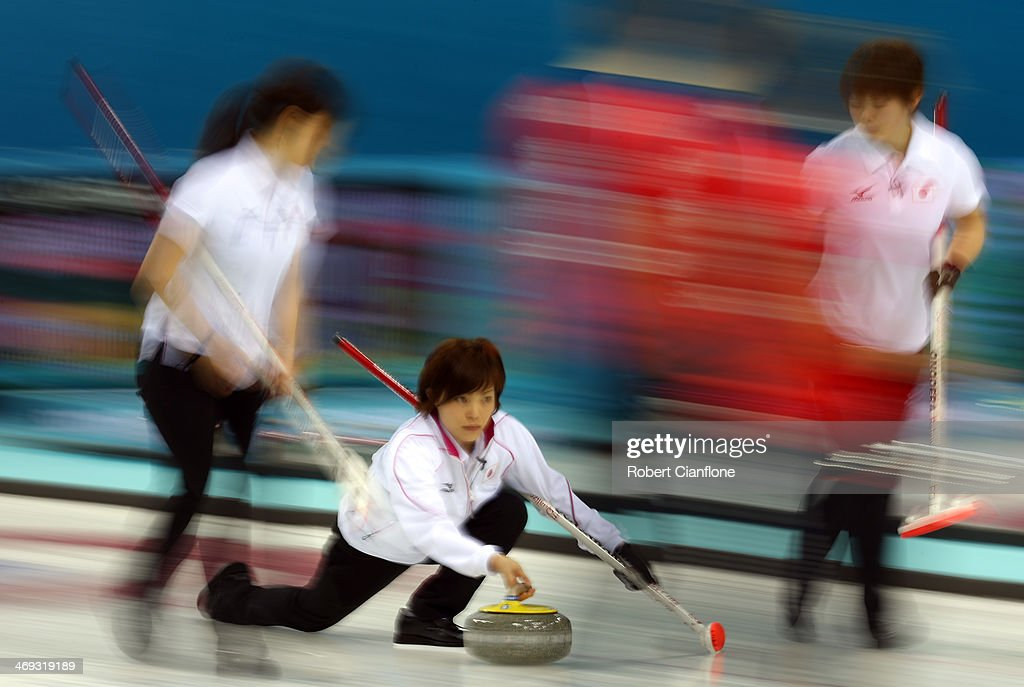 Ayumi Ogasawara of Japan delivers the stone during the Curling Women's Round Robin match between Japan and Great Britain on day seven of the Sochi 2014 Winter Olympics at Ice Cube Curling Center on February 14, 2014 in Sochi, Russia.
