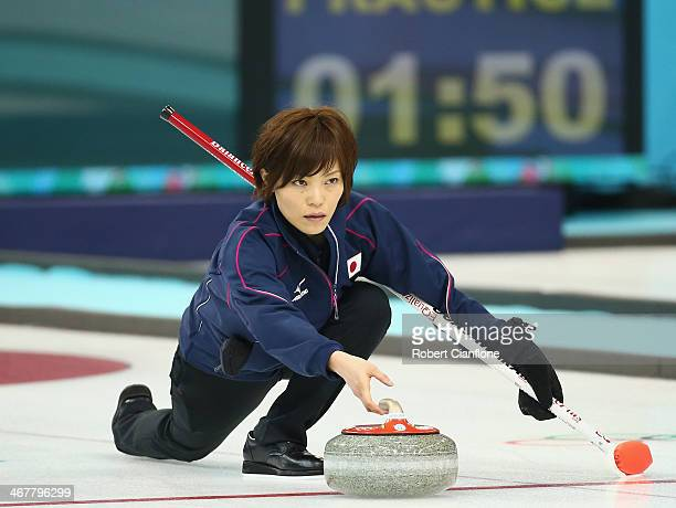 Ayumi Ogasawara of Japan release the rock during curling training on day 1 of the Sochi 2014 Winter Olympics at the Ice Cube on February 8 2014 in...
