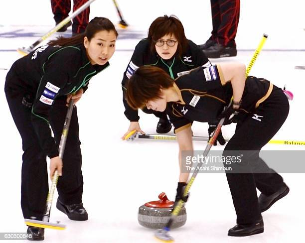 Ayumi Ogasawara of Team Hokkaido Bank delivers the stone in the Women's first round during day three of the Karuizawa International Curling...