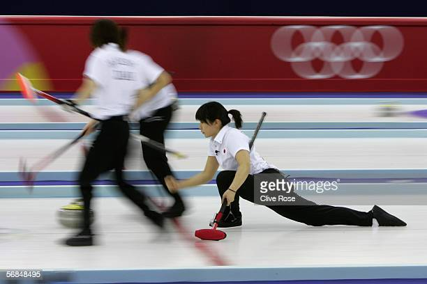 Ayumi Onodera of Japan in action during the preliminary round of the women's curling between USA and Japan during Day 4 of the Turin 2006 Winter...