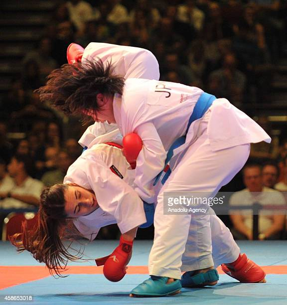 Ayumi Uekusa of Japan fights against her opponent Meltem Hocaoglu of Turkey during the women's third place 68kg Kumite competition of the 22nd Karate...