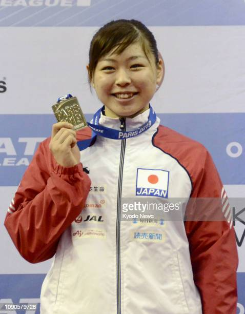 Ayumi Uekusa of Japan holds her gold medal after winning the women's kumite over68 kilogram class at the Karate 1 Premier League in Paris on Jan 27...