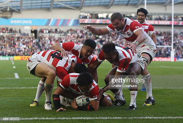 Ayumu Goromaru of Japan celebrates scoring his teams during the 2015 Rugby World Cup Pool B match between South Africa and Japan at the Brighton...