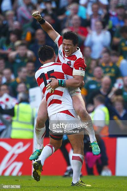 Ayumu Goromaru of Japan celebrates with Harumichi Tatekawa of Japan following victory in the 2015 Rugby World Cup Pool B match between South Africa...