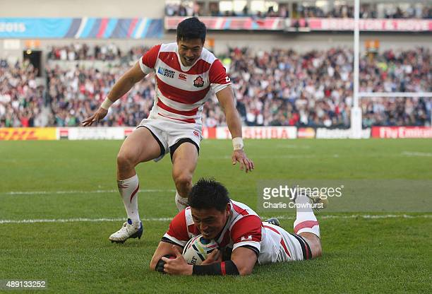 Ayumu Goromaru of Japan dives over to score his team's second try during the 2015 Rugby World Cup Pool B match between South Africa and Japan at the...
