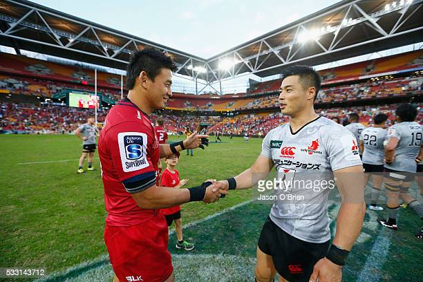 Ayumu Goromaru of the reds shakes hands with Akihito Yamada during the round 13 Super Rugby match between the Reds and the Sunwolves at Suncorp...