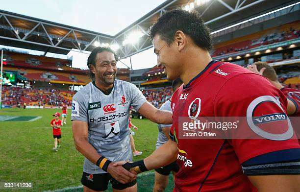 Ayumu Goromaru of the reds shakes hands with Hitoshi Ono during the round 13 Super Rugby match between the Reds and the Sunwolves at Suncorp Stadium...