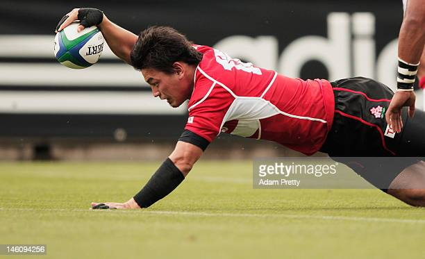 Ayumu Gorumaru of Japan goes over for a try during the IRB Pacific Nations Cup match between Japan and Tonga at Prince Chichibu Memorial Stadium on...